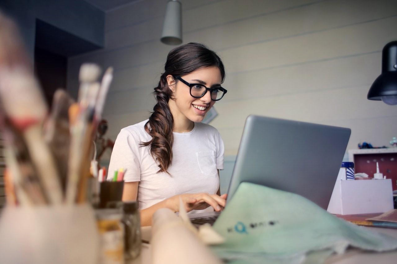 girl happy at laptop